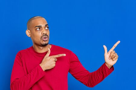 African guy with red jersey on a blue background
