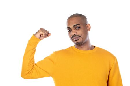 African guy with yellow T-shirt isolated on a white background Standard-Bild