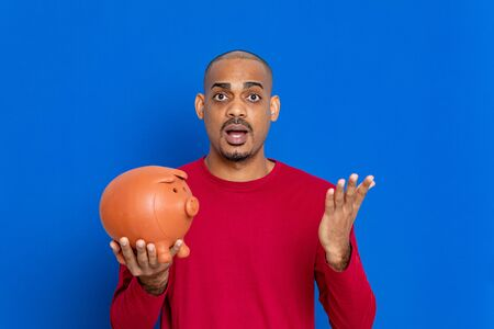 African guy with a red jersey on a blue background