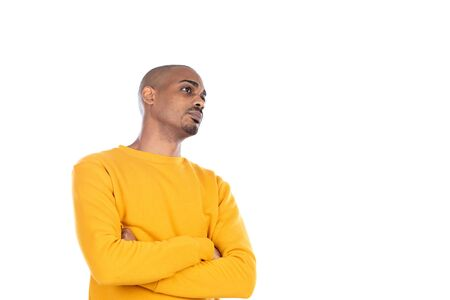 Afroamerican guy wearing a yellow jersey isolated on a white background