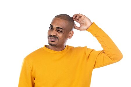 Afroamerican guy wearing a yellow jersey isolated on a white background Stok Fotoğraf