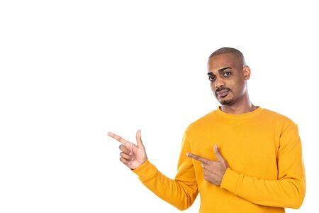 Afroamerican guy wearing a yellow jersey isolated on a white background Banco de Imagens