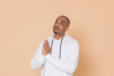 African guy with a white sweatshirt on a yellow background