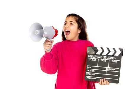 Adorable girl with a Clapperboard and a megaphone, isolated on a white background