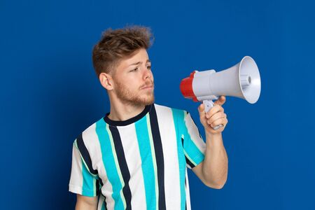 Attractive young guy with a striped T-shirt isolated on a white background