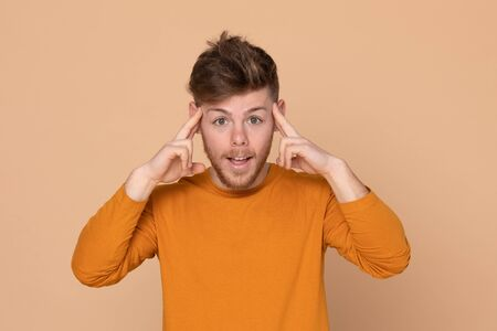 Attractive young guy on a yellow background