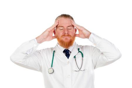 Redhead doctor with a medical gown isolated on a white background
