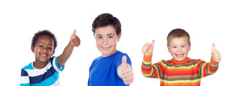 Happy classmates saying Ok with their thumbs up isolated on a white background Stockfoto