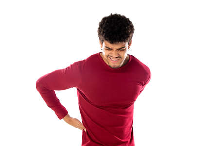 Cute african american man with afro hairstyle wearing a burgundy T-shirt isolated on a white background Stock Photo