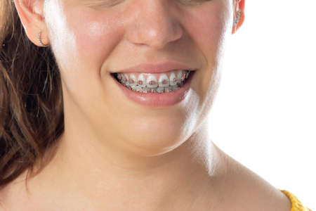 Close-up portrait of cheerful woman isolated on a white background