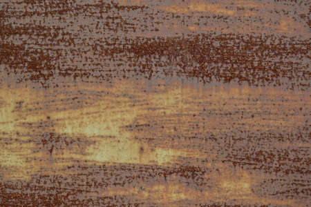 Texture of old rusty painted and worn brown metal