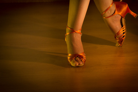 Feet woman dancing with heeled sandals. Stock Photo