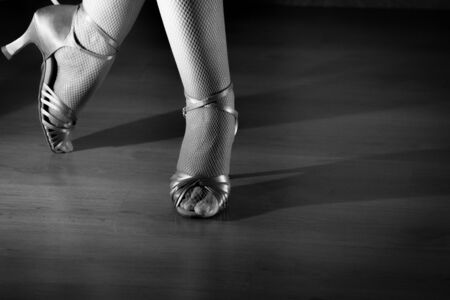women s legs: Feet woman dancing with heeled sandals. Stock Photo