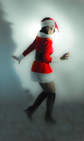 papa noel: Woman dressed in santa claus. Papa noel.
