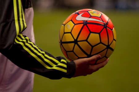 endorsing: Man with soccer ball supporter. Stock Photo