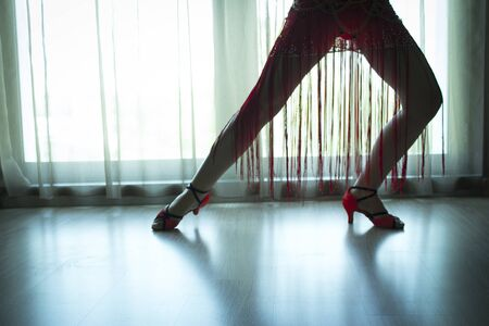 Woman legs in dancing pose. Stock Photo
