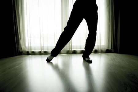milonga: Legs of man dancing with white shoes and black. Stock Photo
