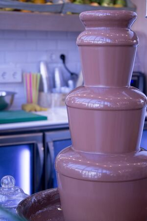 calorie rich food: Chocolate fountain in a kitchen
