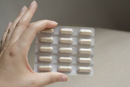 sustained: Tablet pills sustained by a woman hand