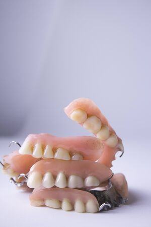 artificial teeth: Studio shot of a various dentures, false teeth, isolated on white.