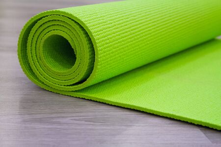 complement: Complement stretching exercise. Yoga mat