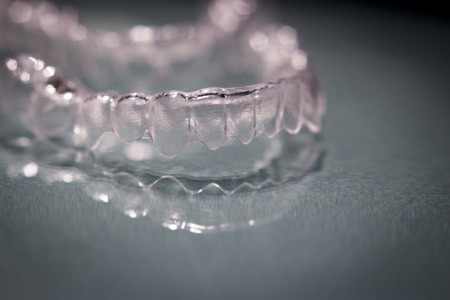 invisible: Part of invisible braces on grey background Stock Photo