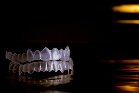 invisible: Invisible orthodontics on black background and gold