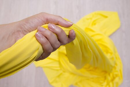 aerobatics: Yellow fabric for aerobatics held by womans hand