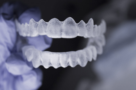 Dentists hand with latex gloves holding a dental orthodontic