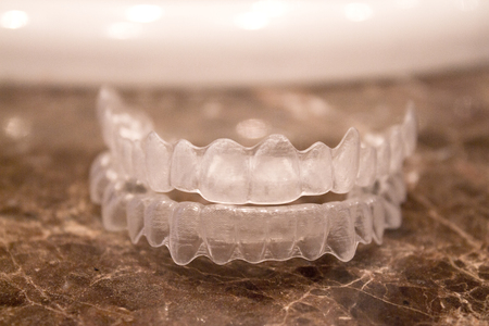 Invisible orthodontics for aligning teeth
