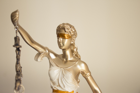 specific: White female statue symbol of justice Themis. This figure has not specific author, no model release needed.