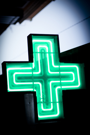 Luminous green cross. No people