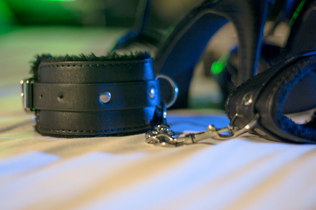 Handcuffs for erotic games. Submission. Bondage.