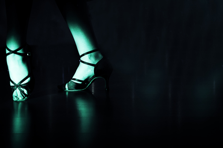 Woman with red dancing sandals in disco Banco de Imagens