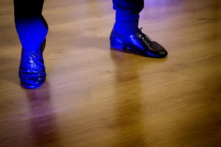 Feet dancer dancing salsa. Copy space Stock Photo