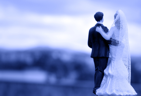 Newlyweds on their backs with unfocused background. Standard figure without defined author Stock fotó