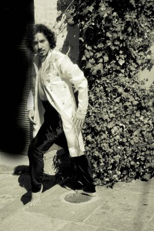Bollywood dancer man over urban background Standard-Bild - 131775384