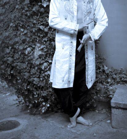 Bollywood dancer man over urban background Standard-Bild - 131774860