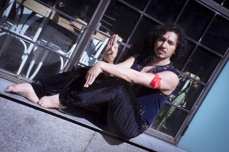 Bollywood dancer man over urban background Standard-Bild - 131775376