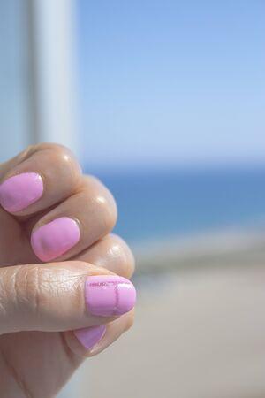 Semipermanent pink gel painted nails