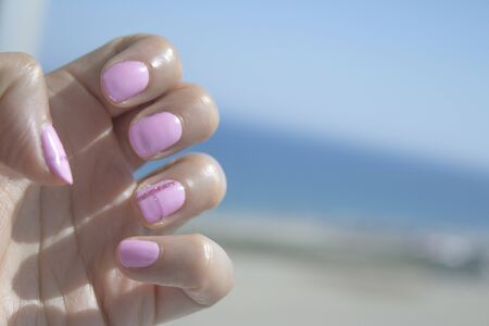 Semipermanent pink gel painted nails