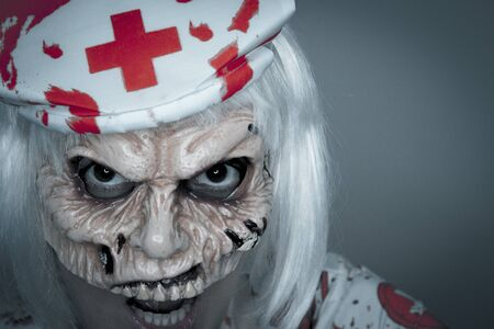 Woman dressed as a killer nurse for Halloween night