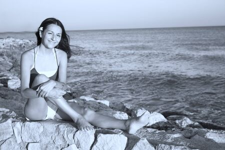 Young girl with cheerful expression on the beach