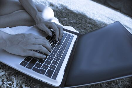 Laptop on the grass, working in the field with relaxation Stock Photo