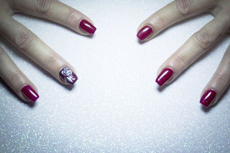Female manicure in red tones. Copy space Stock Photo