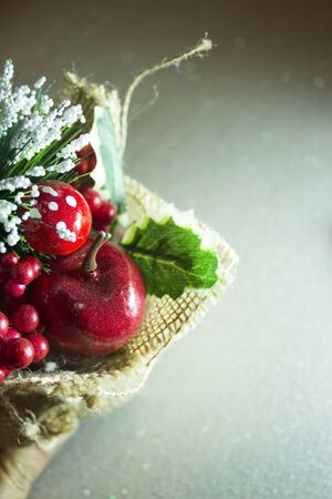 Christmas ornament with holly and red berries. Copy space