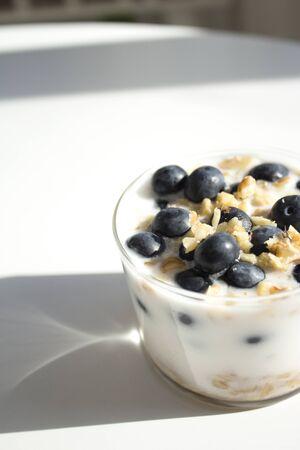 Yogurt dessert with cranberries and almonds. Raw food Stock Photo