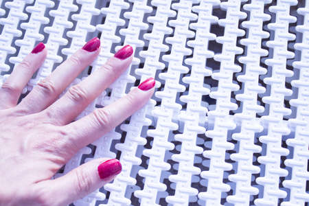 Womans hand with red painted nails. Copy space Stock Photo