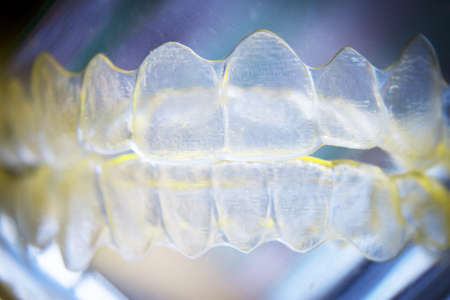 Invisible dental orthodontic submerged in water for cleaning