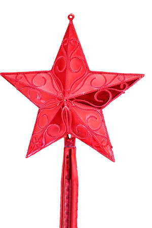 Shining red star set high up on white christmas tree. No people 写真素材